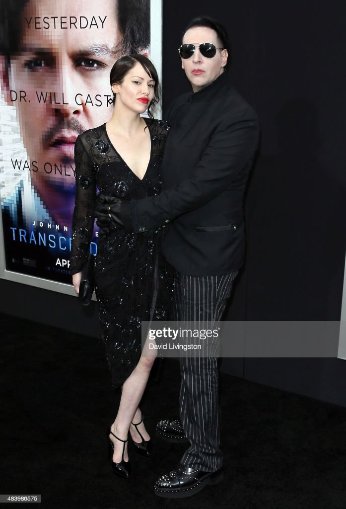 Recording artist <a gi-track='captionPersonalityLinkClicked' href=/galleries/search?phrase=Marilyn+Manson&family=editorial&specificpeople=208980 ng-click='$event.stopPropagation()'>Marilyn Manson</a> (R) and Lindsay Usich attend the premiere of Warner Bros. Pictures and Alcon Entertainment's 'Transcendence' at the Regency Village Theatre on April 10, 2014 in Westwood, California.