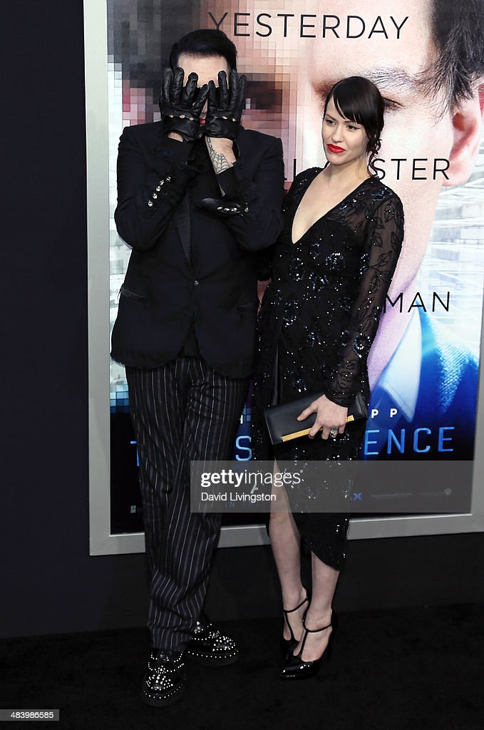 Recording artist <a gi-track='captionPersonalityLinkClicked' href=/galleries/search?phrase=Marilyn+Manson&family=editorial&specificpeople=208980 ng-click='$event.stopPropagation()'>Marilyn Manson</a> (L) and Lindsay Usich attend the premiere of Warner Bros. Pictures and Alcon Entertainment's 'Transcendence' at the Regency Village Theatre on April 10, 2014 in Westwood, California.