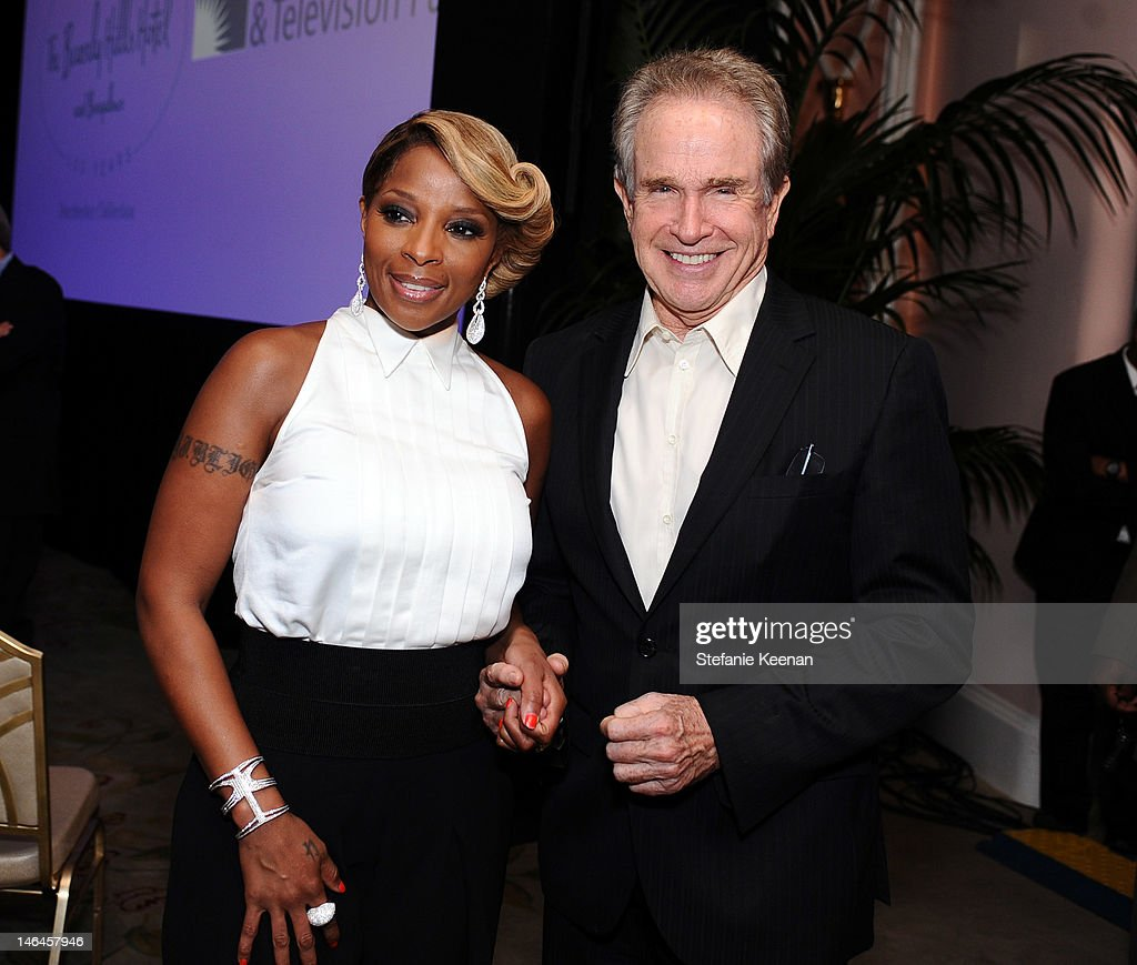 Recording artist Mary J. Blige (L) and host Warren Beatty attend the 100th anniversary celebration of the Beverly Hills Hotel & Bungalows supporting the Motion Picture & Television Fund and the American Comedy Fund hosted by Brett Ratner and Warren Beatty at Beverly Hills Hotel on June 16, 2012 in Beverly Hills, California.