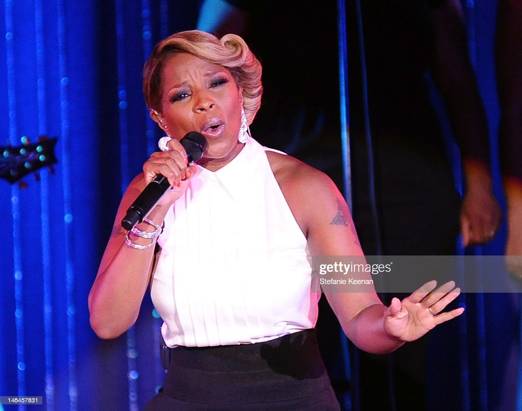 Recording artist Mary J. Blige performs at the 100th anniversary celebration of the Beverly Hills Hotel & Bungalows supporting the Motion Picture & Television Fund and the American Comedy Fund hosted by Brett Ratner and Warren Beatty at Beverly Hills Hotel on June 16, 2012 in Beverly Hills, California.