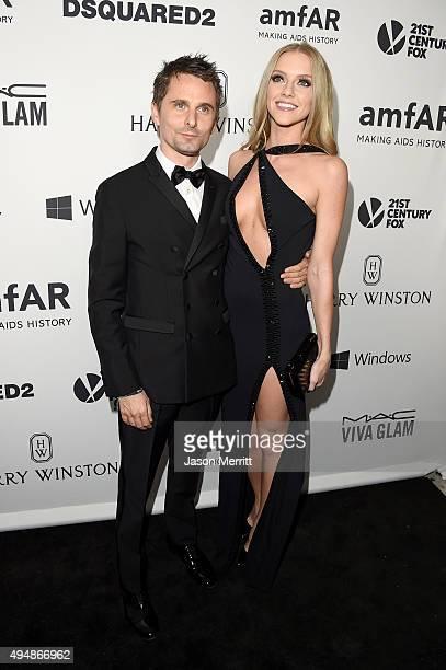 Recording artist Matthew Bellamy of Muse and model Elle Evans attend amfAR's Inspiration Gala Los Angeles at Milk Studios on October 29 2015 in...