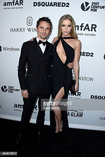 Recording artist Matthew Bellamy of Muse and model Elle Evans attend amfAR's Inspiration Gala Los Angeles at Milk Studios on October 29 2015 in...