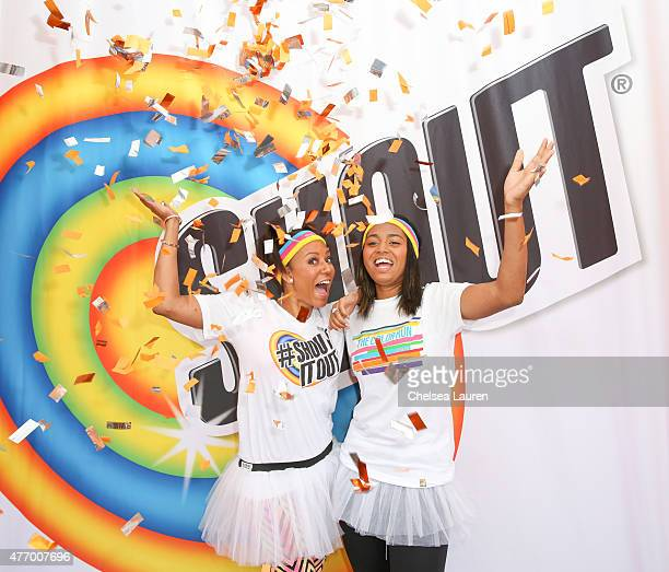 Recording artist Mel B and daughter Phoenix in the Shout® glitter bomb selfie booth at The Color Run at Dodger Stadium on June 13 2015 in Los Angeles...