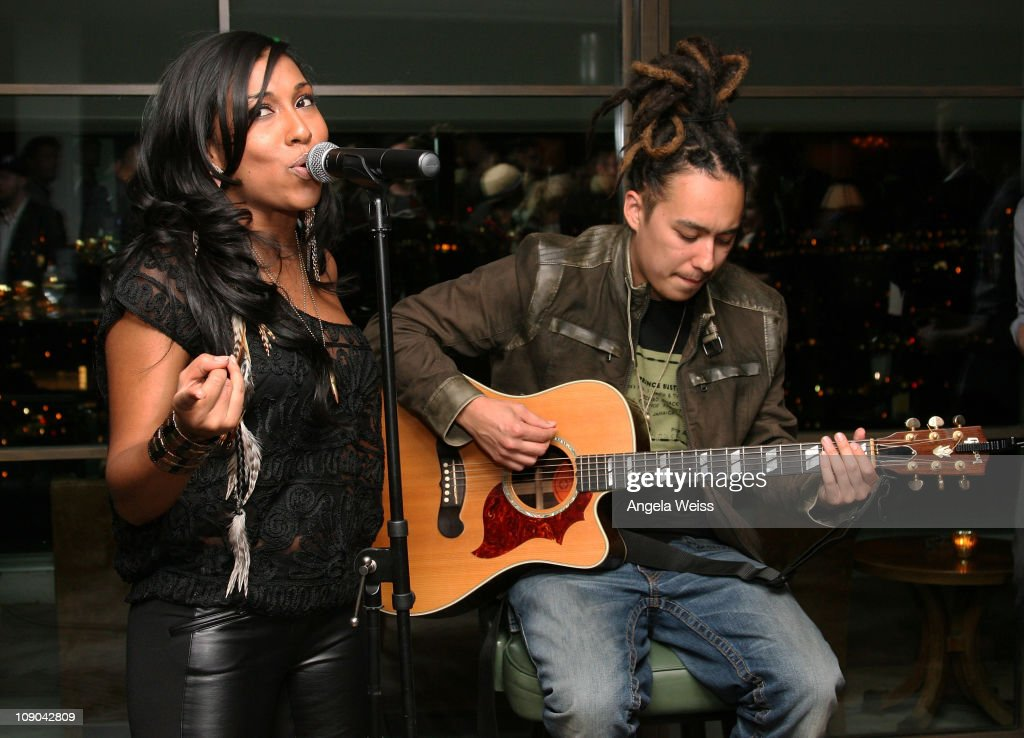 Recording artist Melanie Fiona and guitarist Steve Wyreman perform at the RADD Grey Goose Party at Soho House on February 12 2011 in West Hollywood...