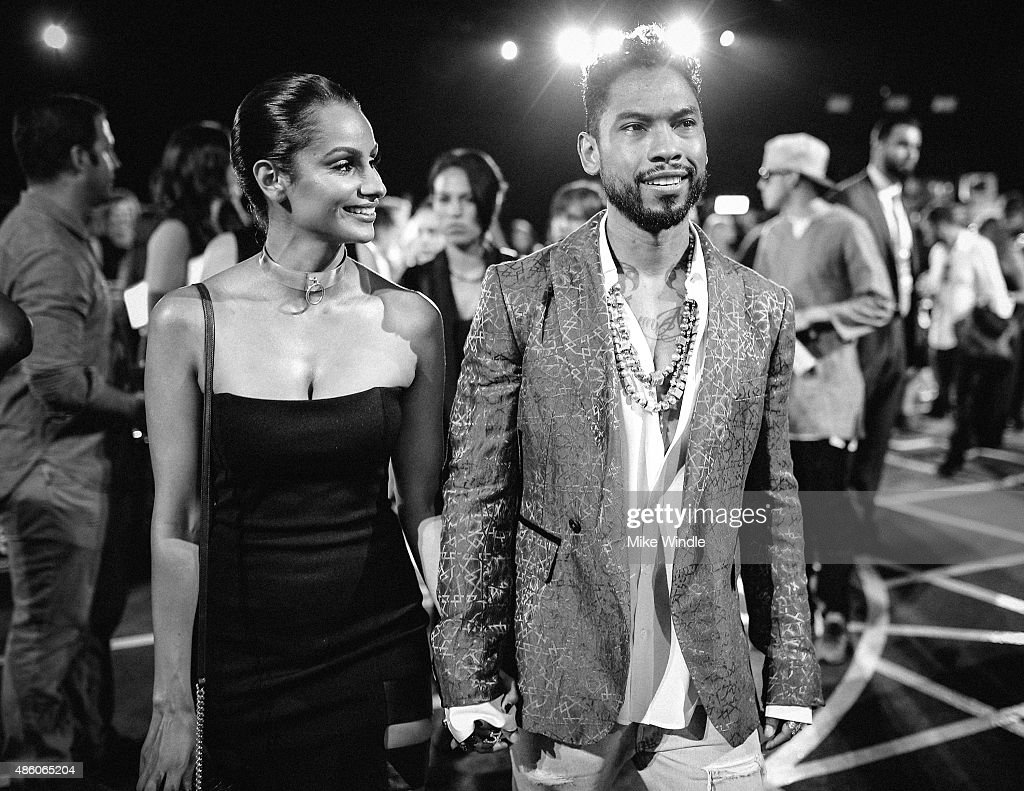 Recording artist Miguel (R) and Nazanin Mandi attend the 2015 MTV Video Music Awards at Microsoft Theater on August 30, 2015 in Los Angeles, California.