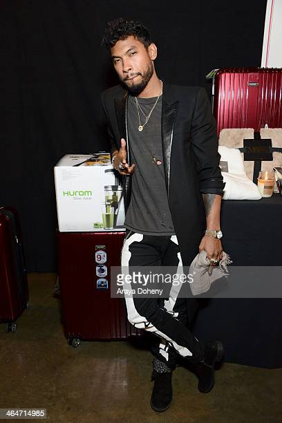 Recording artist Miguel attends the 2014 MusiCares Person of the Year rehearsals Double Platinum Gift Lounge and auction signings at the Los Angeles...