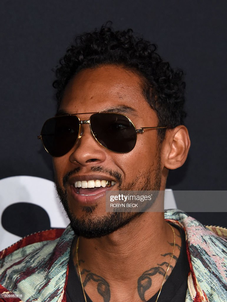 Recording artist Miguel attends the Yves Saint Laurent men's fall line and the first part of its women's collection fashion show at the Paladium, in Hollywood, California, February 10, 2016. / AFP / ROBYN BECK