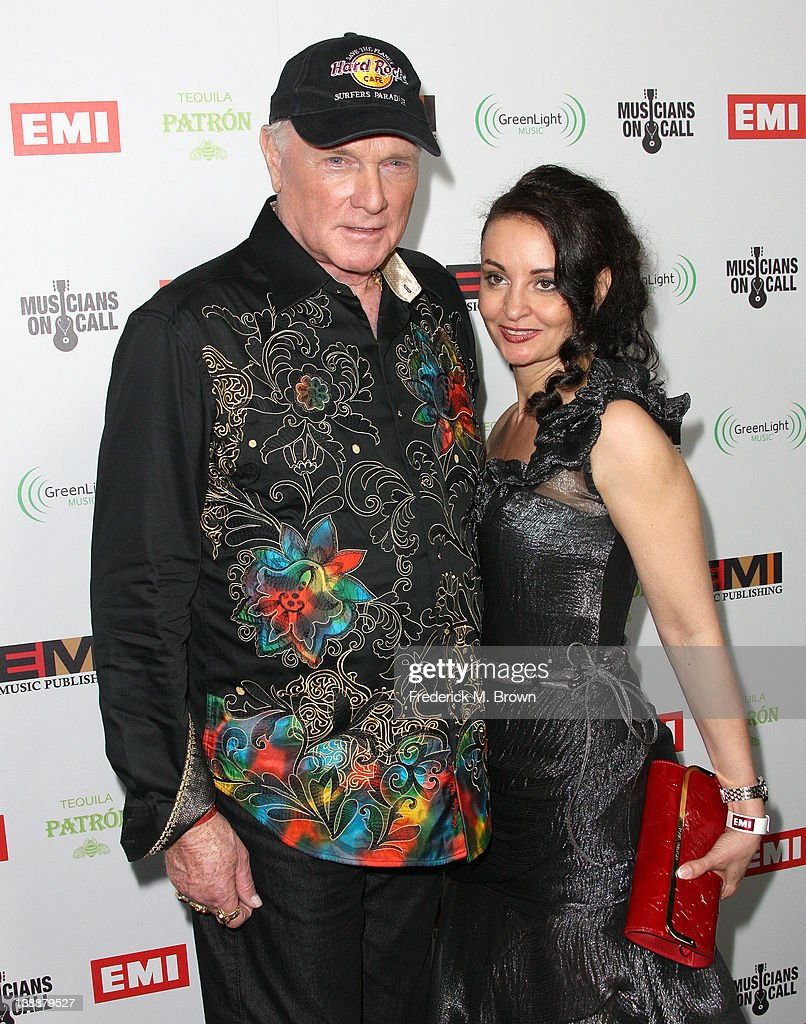 Recording artist <a gi-track='captionPersonalityLinkClicked' href=/galleries/search?phrase=Mike+Love&family=editorial&specificpeople=93771 ng-click='$event.stopPropagation()'>Mike Love</a> (C) and his guest attend the EMI GRAMMY After Party at the Capital Records Building on February 12, 2012 in Hollywood, California.