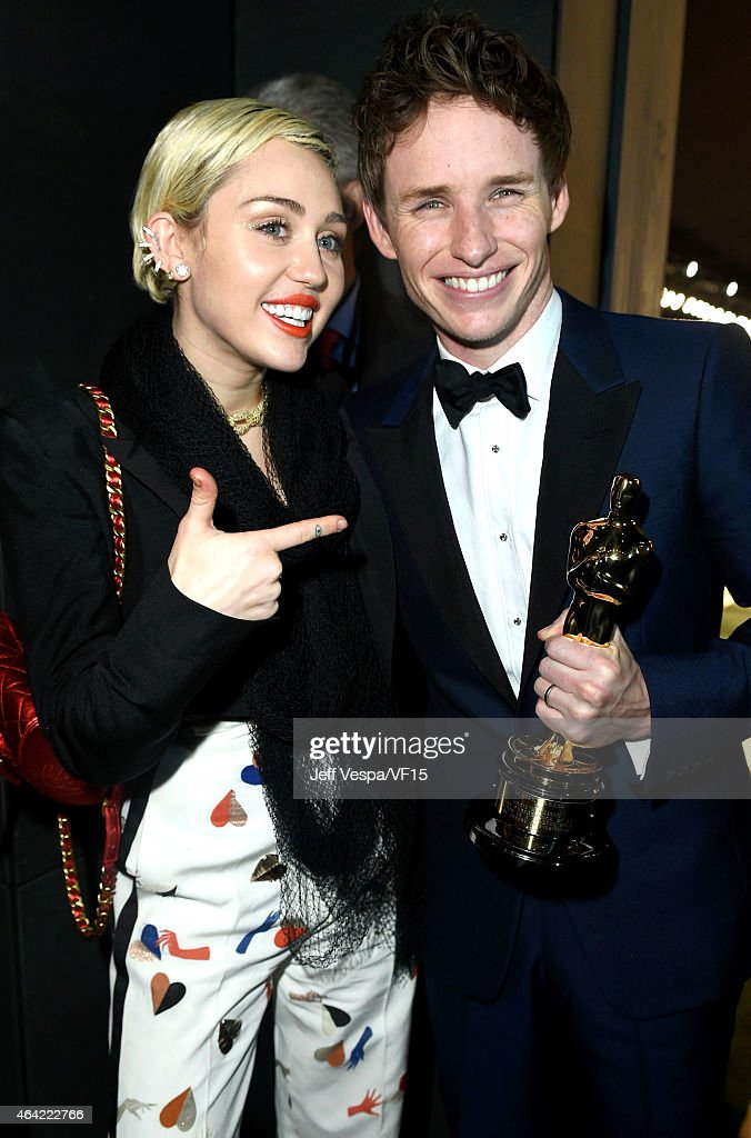 Recording artist Miley Cyrus and actor Eddie Redmayne attend the 2015 Vanity Fair Oscar Party hosted by Graydon Carter at the Wallis Annenberg Center...