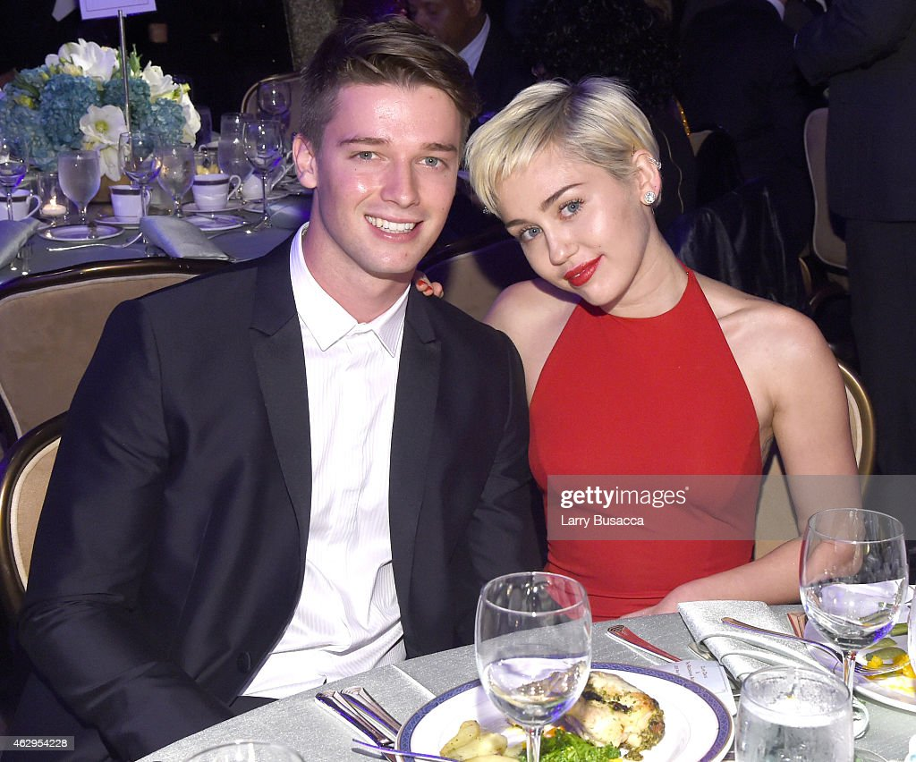 Recording artist Miley Cyrus and Patrick Schwarzenegger attend the PreGRAMMY Gala and Salute to Industry Icons honoring Martin Bandier at The Beverly...