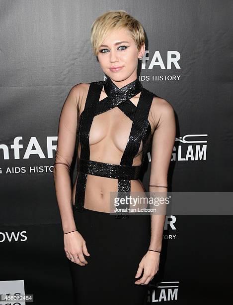 Recording artist Miley Cyrus attends amfAR LA Inspiration Gala honoring Tom Ford at Milk Studios on October 29 2014 in Hollywood California