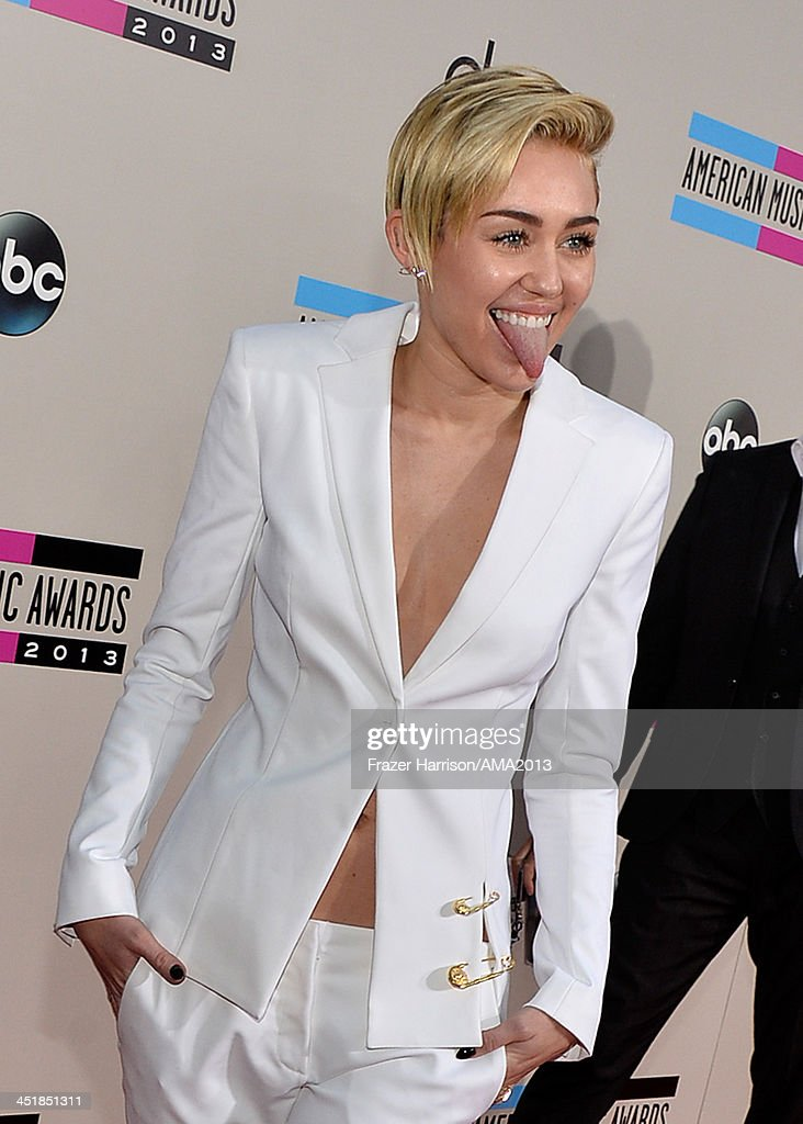 Recording artist <a gi-track='captionPersonalityLinkClicked' href=/galleries/search?phrase=Miley+Cyrus&family=editorial&specificpeople=3973523 ng-click='$event.stopPropagation()'>Miley Cyrus</a> attends the 2013 American Music Awards at Nokia Theatre L.A. Live on November 24, 2013 in Los Angeles, California.