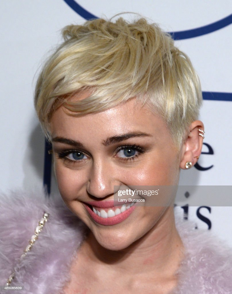 Recording artist <a gi-track='captionPersonalityLinkClicked' href=/galleries/search?phrase=Miley+Cyrus&family=editorial&specificpeople=3973523 ng-click='$event.stopPropagation()'>Miley Cyrus</a> attends the 56th annual GRAMMY Awards Pre-GRAMMY Gala and Salute to Industry Icons honoring Lucian Grainge at The Beverly Hilton on January 25, 2014 in Beverly Hills, California.