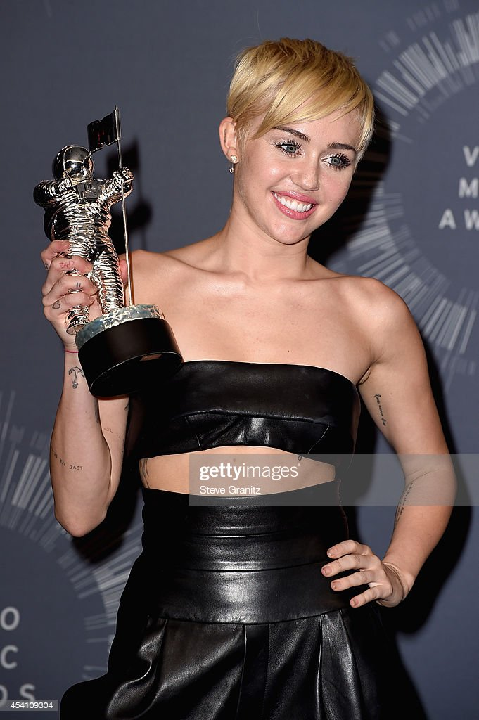 Recording artist Miley Cyrus poses in the press room during the 2014 MTV Video Music Awards at The Forum on August 24, 2014 in Inglewood, California.