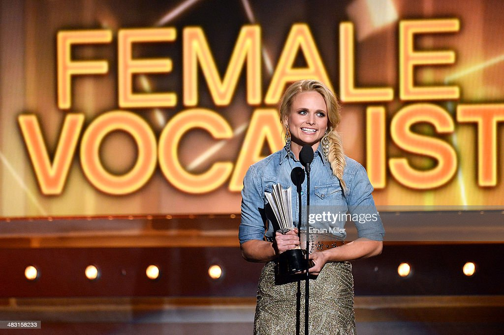 Recording artist <a gi-track='captionPersonalityLinkClicked' href=/galleries/search?phrase=Miranda+Lambert&family=editorial&specificpeople=571972 ng-click='$event.stopPropagation()'>Miranda Lambert</a> accepts the Female Vocalist of the Year award onstage during the 49th Annual Academy of Country Music Awards at the MGM Grand Garden Arena on April 6, 2014 in Las Vegas, Nevada.