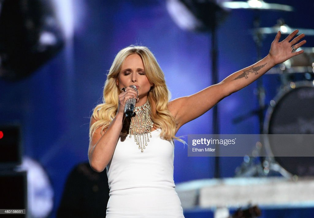 Recording artist <a gi-track='captionPersonalityLinkClicked' href=/galleries/search?phrase=Miranda+Lambert&family=editorial&specificpeople=571972 ng-click='$event.stopPropagation()'>Miranda Lambert</a> performs onstage during the 49th Annual Academy of Country Music Awards at the MGM Grand Garden Arena on April 6, 2014 in Las Vegas, Nevada.