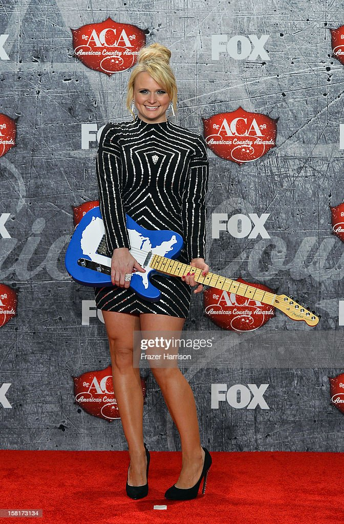 Recording artist <a gi-track='captionPersonalityLinkClicked' href=/galleries/search?phrase=Miranda+Lambert&family=editorial&specificpeople=571972 ng-click='$event.stopPropagation()'>Miranda Lambert</a> poses in the press room with her award for Female Single of the Year during the 2012 American Country Awards at the Mandalay Bay Events Center on December 10, 2012 in Las Vegas, Nevada.