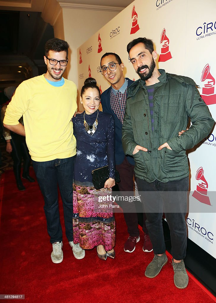Recording artist <a gi-track='captionPersonalityLinkClicked' href=/galleries/search?phrase=Natalia+Lafourcade&family=editorial&specificpeople=2816222 ng-click='$event.stopPropagation()'>Natalia Lafourcade</a> (second from left) poses with La Vida Bohème members Daniel De Sousa (far left), Henry D'Arthenay (second from right), and Sebastian Ayala (far right) at the 14th Annual Latin GRAMMY Awards after party at the Mandalay Bay Events Center on November 21, 2013 in Las Vegas, Nevada.