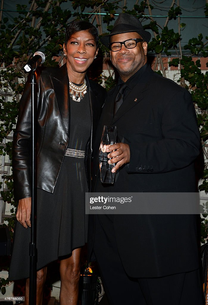 Recording artist Natalie Cole accepts the 'Songs of Hope Hitmaker Award' onstage from emcee Jimmy Jam during City Of Hope's 11th Annual 'Songs Of...