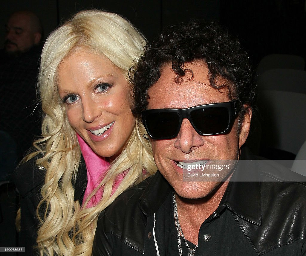 Recording artist Neal Schon (R) and Michaele Salahi attend the 2013 NAMM Show - Day 2 at the Anaheim Convention Center on January 25, 2013 in Anaheim, California.