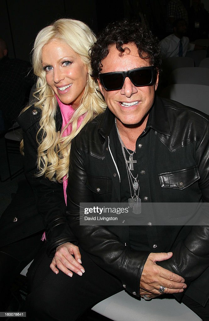 Recording artist <a gi-track='captionPersonalityLinkClicked' href=/galleries/search?phrase=Neal+Schon&family=editorial&specificpeople=595042 ng-click='$event.stopPropagation()'>Neal Schon</a> (R) and Michaele Salahi attend the 2013 NAMM Show - Day 2 at the Anaheim Convention Center on January 25, 2013 in Anaheim, California.