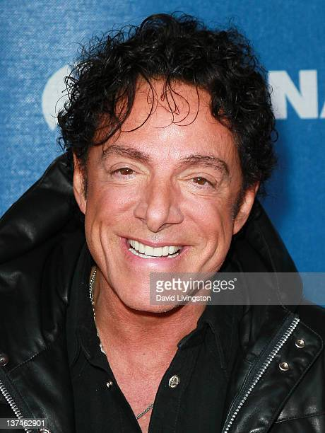 Recording artist Neal Schon of Journey attends the 110th NAMM Show Day 2 at the Anaheim Convention Center on January 20 2012 in Anaheim California