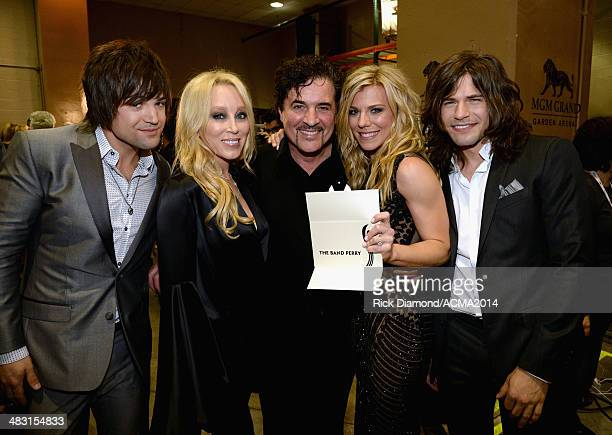 Recording artist Neil Perry Big Machine Records Vice President Sandi Spika Borchetta Big Machine Label Group President and CEO Scott Borchetta...