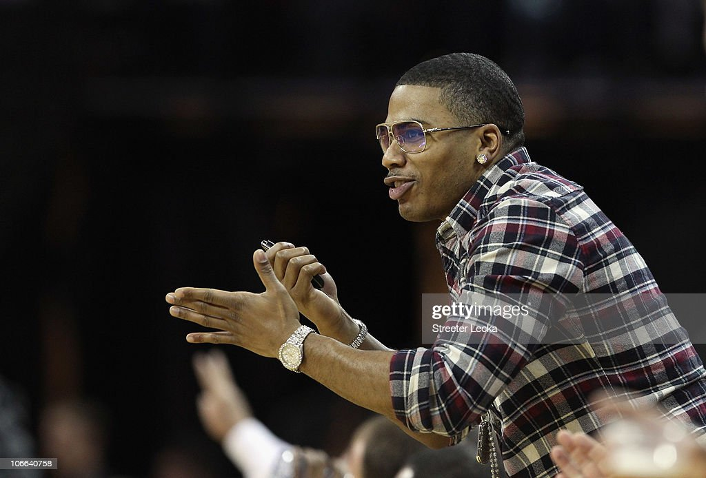 Recording Artist, Nelly, cheers on during the game between the San Antonio Spurs and the Charlotte Bobcats at Time Warner Cable Arena on November 8, 2010 in Charlotte, North Carolina.