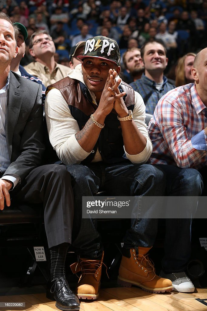 Recording artist Nelly is seen courtside during the game between Philadelphia 76ers and the Minnesota Timberwolves on February 20, 2013 at Target Center in Minneapolis, Minnesota.