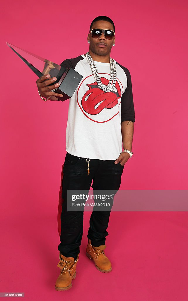 Recording artist Nelly poses for a portrait during the 2013 American Music Awards at Nokia Theatre L.A. Live on November 24, 2013 in Los Angeles, California.