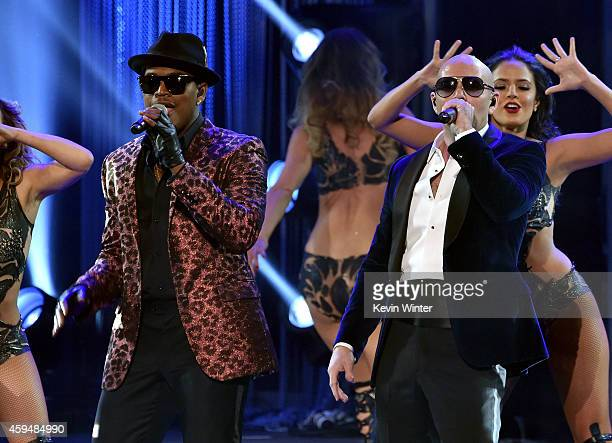 Recording artist NeYo and host Pitbull perform onstage at the 2014 American Music Awards at Nokia Theatre LA Live on November 23 2014 in Los Angeles...