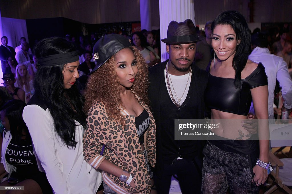 Recording artist <a gi-track='captionPersonalityLinkClicked' href=/galleries/search?phrase=Ne-Yo&family=editorial&specificpeople=451543 ng-click='$event.stopPropagation()'>Ne-Yo</a> (C) attends the FrontRow by Shateria Moragne-El at the STYLE360 Fashion Pavilion in Chelsea on September 11, 2013 in New York City.