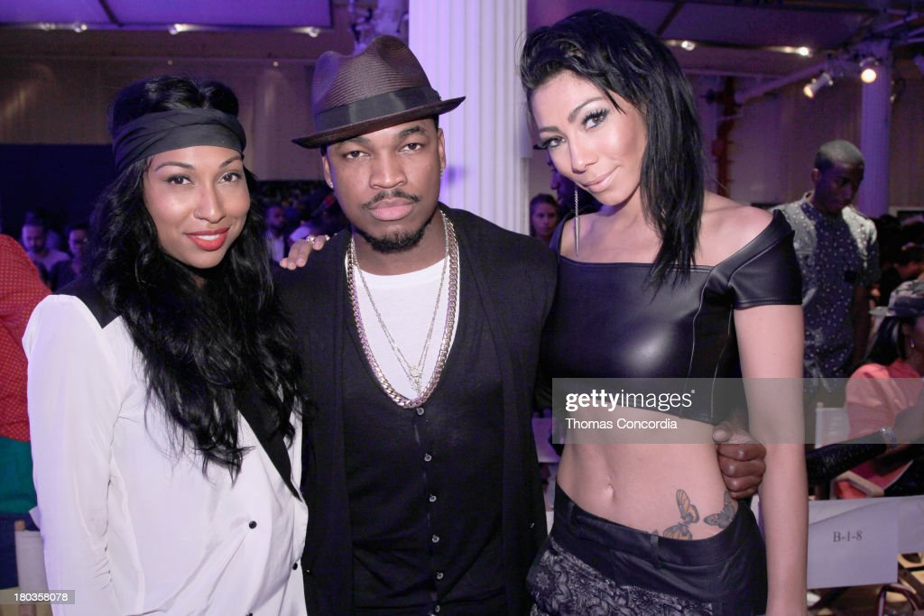 Recording artist <a gi-track='captionPersonalityLinkClicked' href=/galleries/search?phrase=Ne-Yo&family=editorial&specificpeople=451543 ng-click='$event.stopPropagation()'>Ne-Yo</a> (C) poses with recording artista <a gi-track='captionPersonalityLinkClicked' href=/galleries/search?phrase=Melanie+Fiona&family=editorial&specificpeople=5543211 ng-click='$event.stopPropagation()'>Melanie Fiona</a> (L) and Bridget Kelly the FrontRow by Shateria Moragne-El at the STYLE360 Fashion Pavilion in Chelsea on September 11, 2013 in New York City.