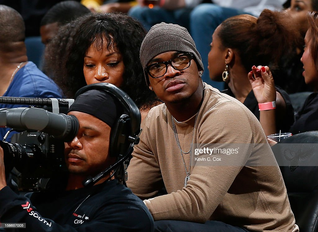 Recording artist Ne-Yo watches the game between the Atlanta Hawks and the Chicago Bulls at Philips Arena on December 22, 2012 in Atlanta, Georgia.