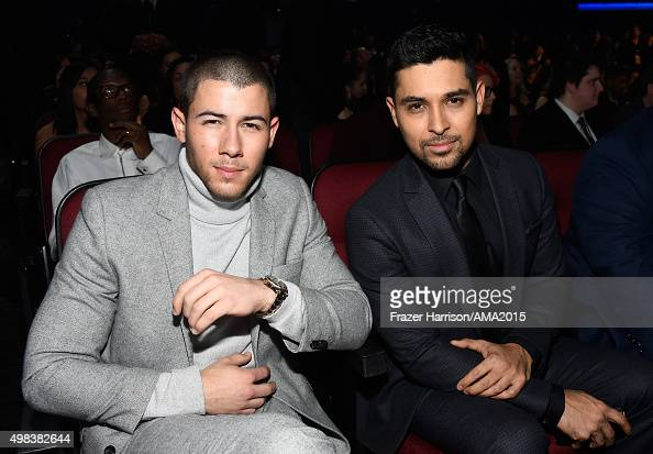 Recording artist Nick Jonas and actor Wilmer Valderrama attend the 2015 American Music Awards at Microsoft Theater on November 22 2015 in Los Angeles...
