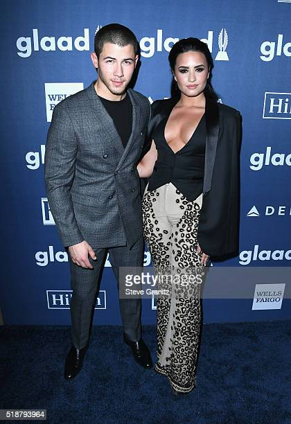 Recording artist Nick Jonas and honoree Demi Lovato attend the 27th Annual GLAAD Media Awards at the Beverly Hilton Hotel on April 2 2016 in Beverly...