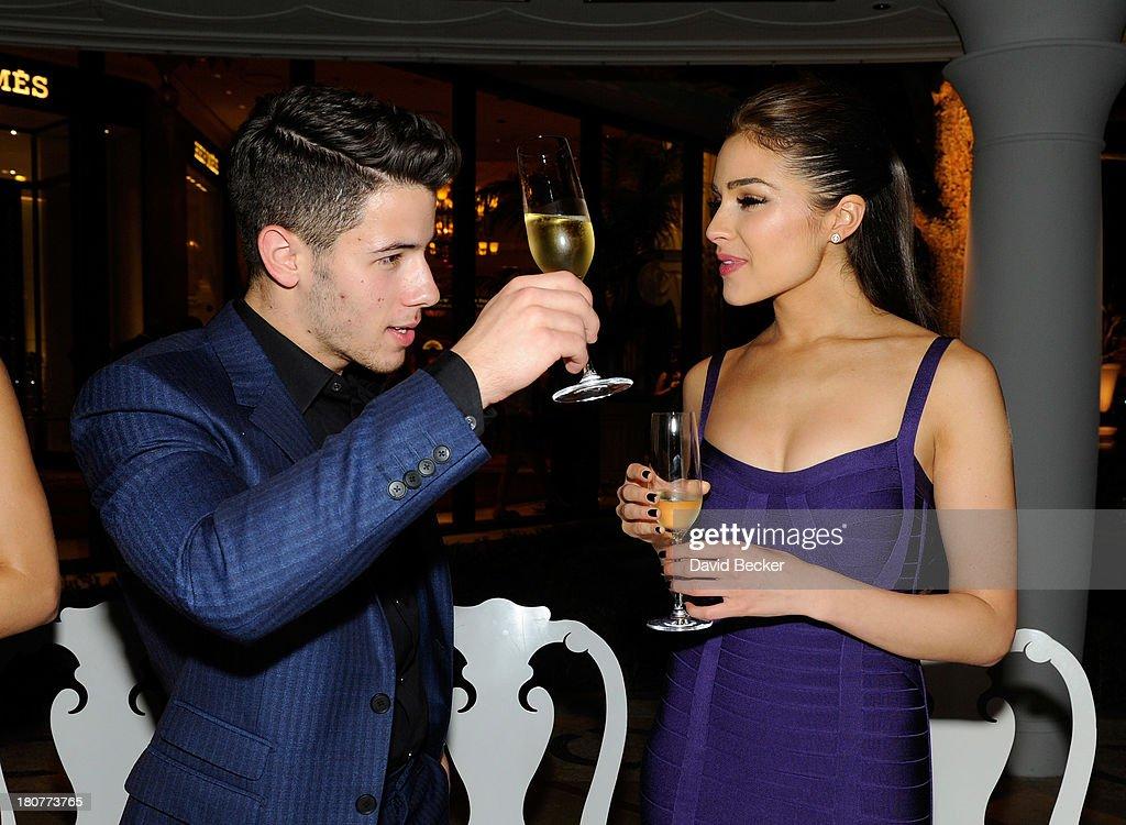 Recording artist Nick Jonas (L) and Miss Universe 2012 Olivia Culpo celebrate his 21st birthday at Botero at Encore Las Vegas on September 16, 2013 in Las Vegas, Nevada.