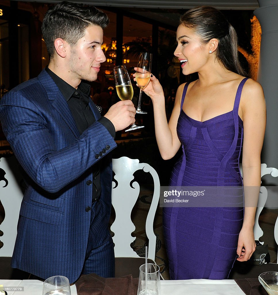 Recording artist Nick Jonas (L) and Miss Universe 2012 Olivia Culpo celebrate his 21st birthday at Botero at Encore Las Vegas on September 16, 2013 in Las Vegas, Nevada.