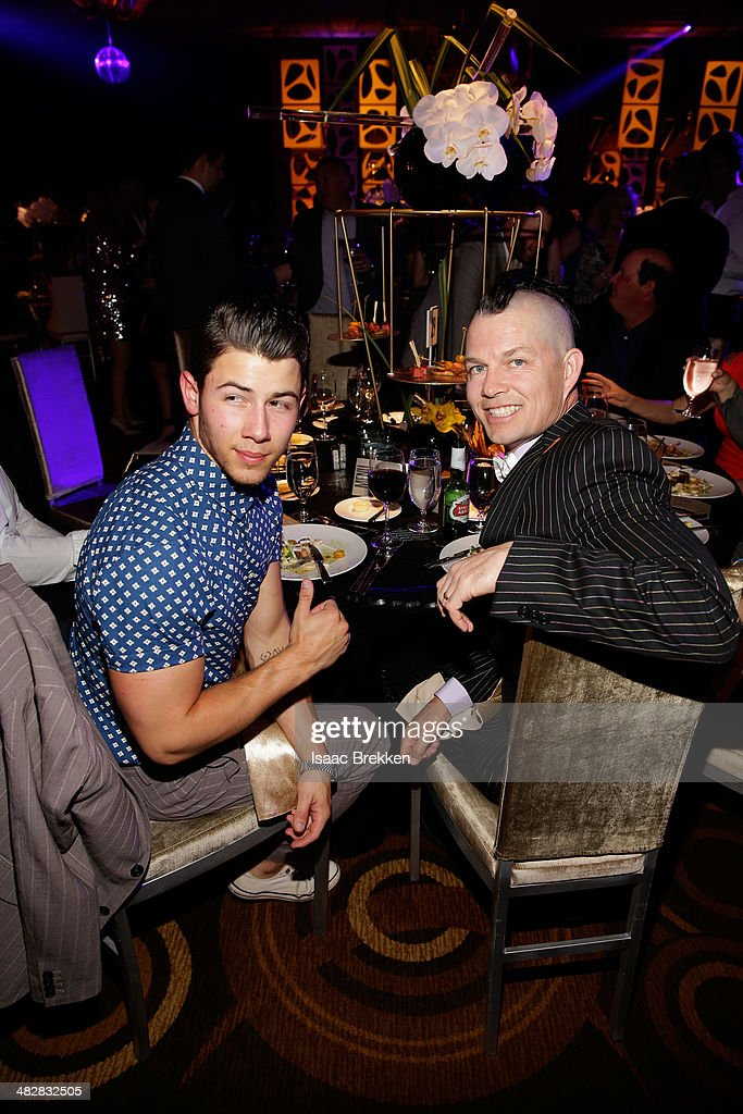 Recording artist Nick Jonas (L) and No Doubt drummer Adrian Young attend the 13th annual Michael Jordan Celebrity Invitational gala at the ARIA Resort & Casino at CityCenter on April 4, 2014 in Las Vegas, Nevada.
