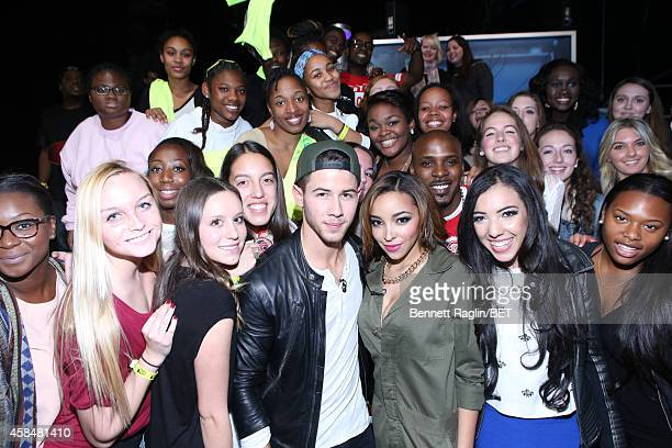 Recording artist Nick Jonas and Tinashe pose for a picture with the 106 Park audience during 106 Park at BET studio on November 5 2014 in New York...
