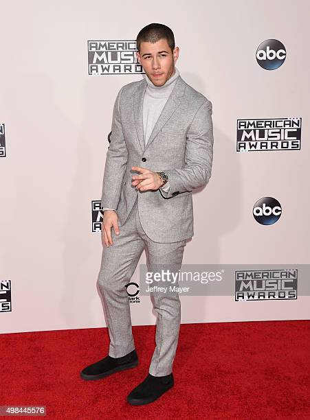 Recording artist Nick Jonas arrives at the 2015 American Music Awards at Microsoft Theater on November 22 2015 in Los Angeles California