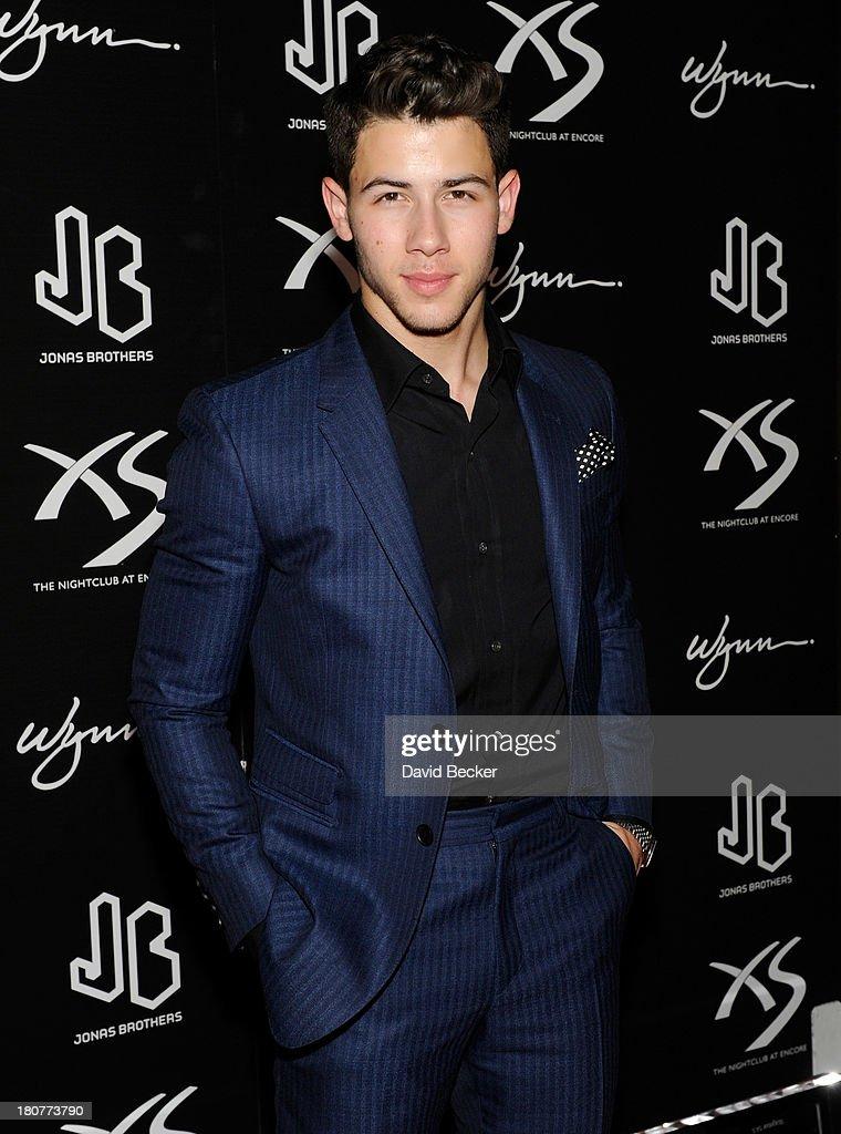Recording artist Nick Jonas arrives at XS The Nightclub at Encore Las Vegas to celebrates his 21st birthday on September 16, 2013 in Las Vegas, Nevada.