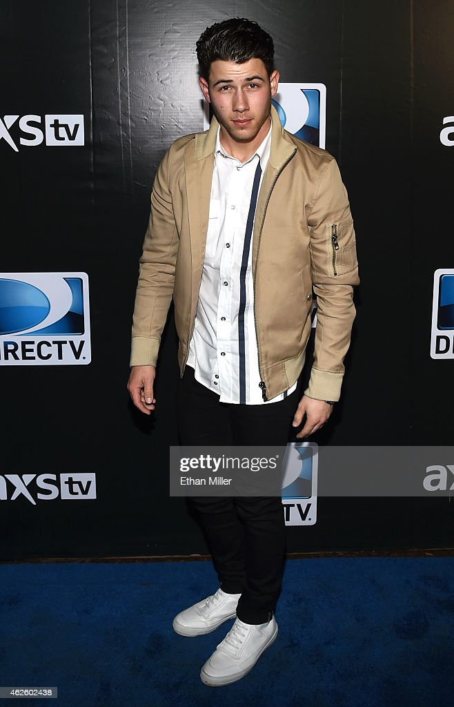 Recording artist Nick Jonas attends DirecTV Super Saturday Night hosted by Mark Cuban's AXS TV and Pro Football Hall of Famer Michael Strahan at...