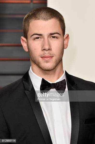 Recording artist Nick Jonas attends the 2016 Vanity Fair Oscar Party Hosted By Graydon Carter at the Wallis Annenberg Center for the Performing Arts...