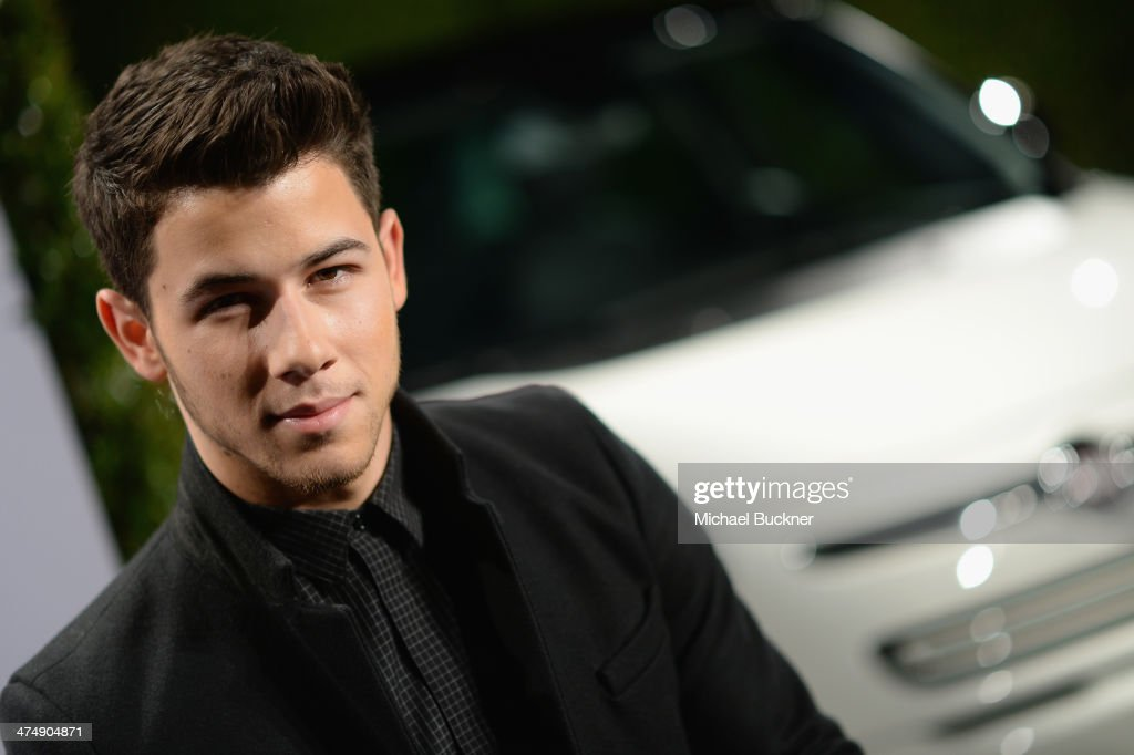 Recording artist <a gi-track='captionPersonalityLinkClicked' href=/galleries/search?phrase=Nick+Jonas&family=editorial&specificpeople=842713 ng-click='$event.stopPropagation()'>Nick Jonas</a> attends Vanity Fair and FIAT celebration of 'Young Hollywood' during Vanity Fair Campaign Hollywood at No Vacancy on February 25, 2014 in Los Angeles, California.