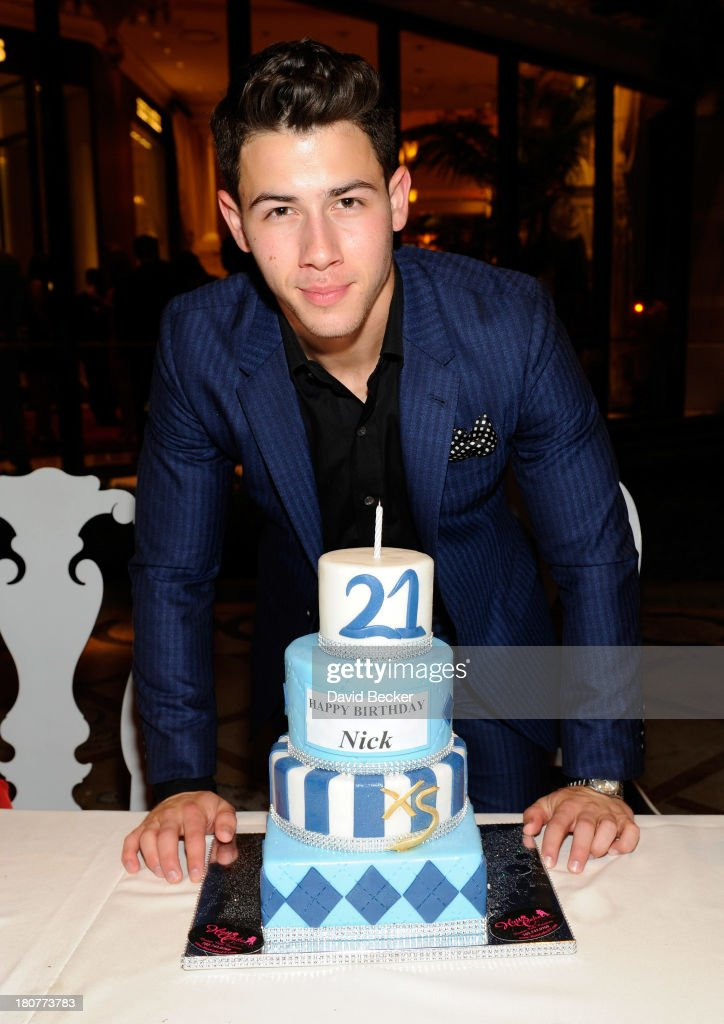 Recording artist <a gi-track='captionPersonalityLinkClicked' href=/galleries/search?phrase=Nick+Jonas&family=editorial&specificpeople=842713 ng-click='$event.stopPropagation()'>Nick Jonas</a> celebrates his 21st birthday at Botero at Encore Las Vegas on September 16, 2013 in Las Vegas, Nevada.