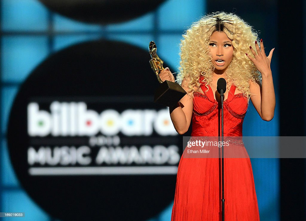 Recording artist Nicki Minaj accepts the award for Top Rap Artist during the 2013 Billboard Music Awards at the MGM Grand Garden Arena on May 19, 2013 in Las Vegas, Nevada.