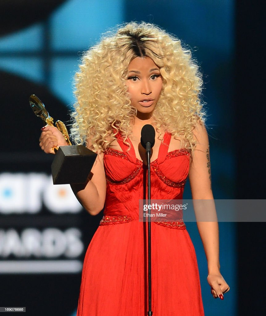 Recording artist Nicki Minaj accepts the awrd for Top Rap Artist onstage during the 2013 Billboard Music Awards at the MGM Grand Garden Arena on May 19, 2013 in Las Vegas, Nevada.