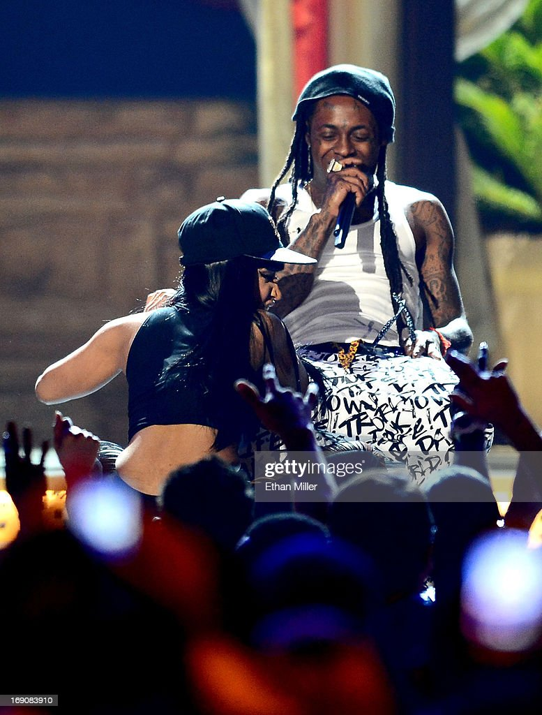 Recording artist Nicki Minaj (L) and rapper Lil Wayne perform onstage during the 2013 Billboard Music Awards at the MGM Grand Garden Arena on May 19, 2013 in Las Vegas, Nevada.