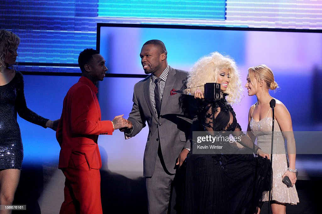 Recording artist Nicki Minaj (C) and rapper Tyga (L) accept the award for Favorite Rap/Hip-Hop Artist from Curtis '50 Cent' Jackson and Hayden Panettiere onstage during the 40th American Music Awards held at Nokia Theatre L.A. Live on November 18, 2012 in Los Angeles, California.